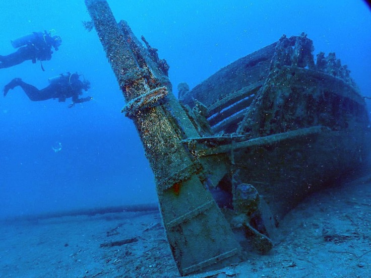 Scuba diving alongside sunken wreck Corfu, Greece